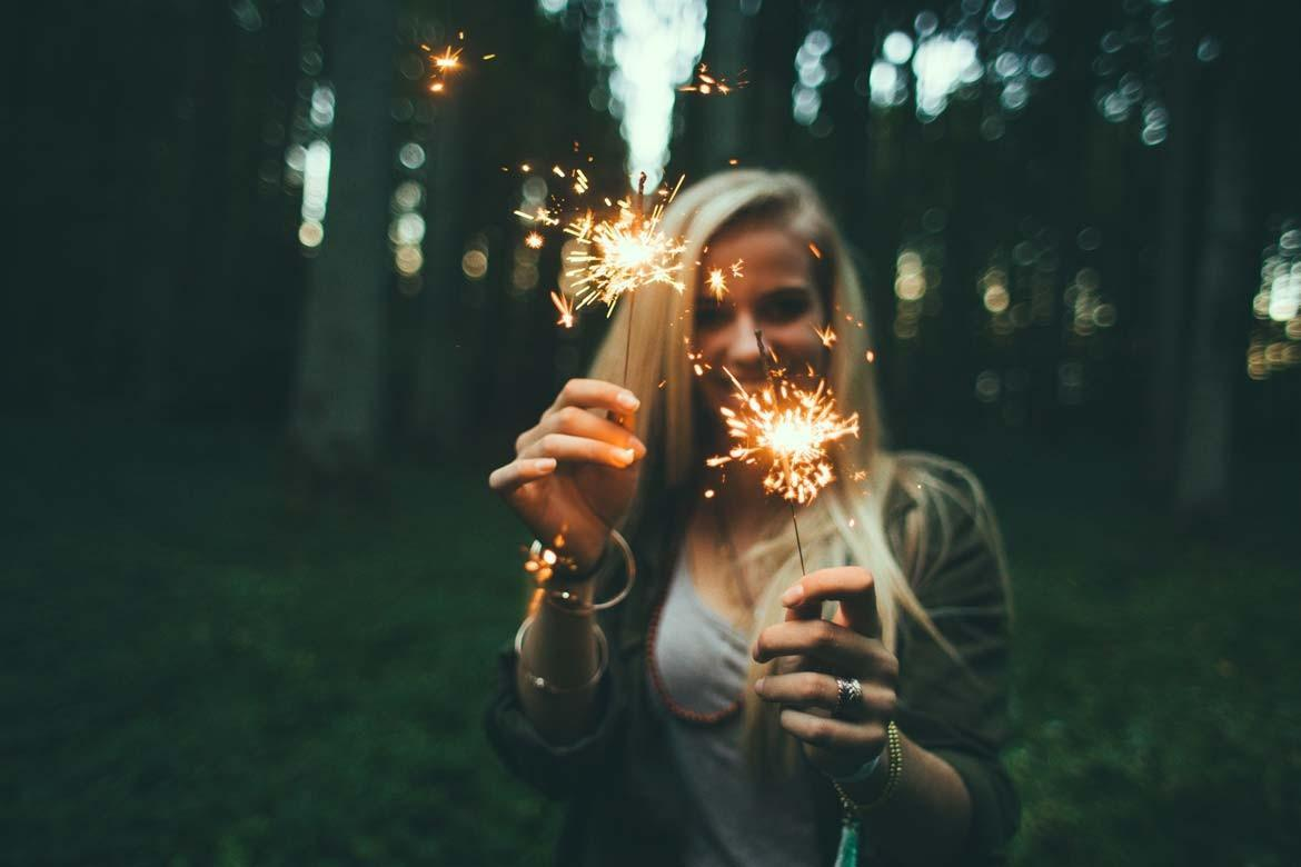 image of girl holding sparkles